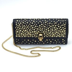 ALEXANDER MCQUEEN Studded Leather Wallet on a Chai